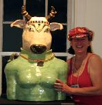 Antonia ( Tuppy) Lawson, bay area ceramic sculptor with her Ceramic sculpture of Holy Cow, Vishnu's Nandi. Anthropomorphic sculpture from the Kitchen God Series